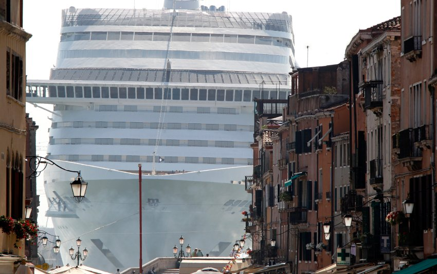 The MSC Divina cruise ship is seen in Venice lagoon June 16, 2012. Environmentalists urged film diva Sophia Loren to help stop a big cruise ship named in her honor from ever entering the Venice lagoon because of potential damage to the city and the lagoon's delicate ecosystem. The MSC Divina (Divine), which the actress christened last month in France, is a 139,500-tonne ship that can carry 3,500 passengers and nearly 1,000 crew. REUTERS/Stefano Rellandini (ITALY - Tags: TRAVEL ENVIRONMENT TRANSPORT) - RTR33Q3O